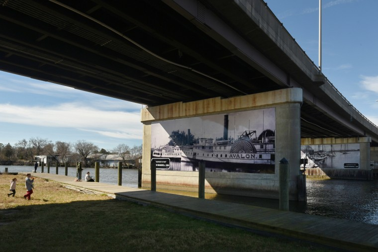 A mural under the bridge depicts the Avalon, one of the steamboats that made weekly stops in West Denton, a commercial maritime center. The river is deep here, preventing slaves from escaping without a boat. Today people fish along the Choptank River at Daniel Crouse Memorial Park.  (Amy Davis/Baltimore Sun)