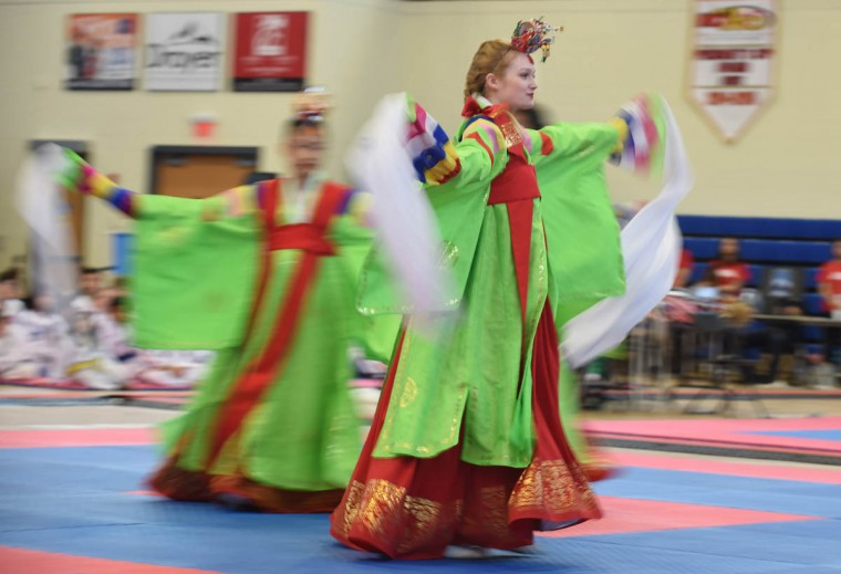 Megan Shinol, of Laurel, and other dancers of the Hee Kyung Lee Korean Traditional Dance team perform Korean Court dance. Over 500 competed in the First Maryland Governor's Cup Taekwondo Championship hosted by the Maryland State Taekwondo Association at the APGFCU Arena Harford Community College. Competitors, ages from 3 to over 60 and from as far as Maine, competed in forms, board breaking and sparring in a full day of contests. All proceeds from the championship will be donated to the Children's Cancer Foundation CCF). (Kenneth K. Lam/The Baltimore Sun)