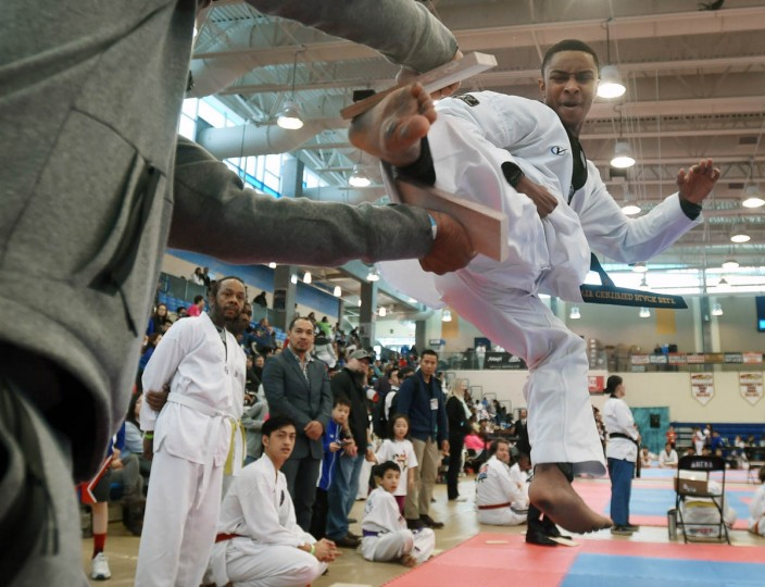 Miles Brooks, 15, of Cockeysville, kicks through a piece of pine board during competition. Over 500 competed in the First Maryland Governor's Cup Taekwondo Championship hosted by the Maryland State Taekwondo Association at the APGFCU Arena Harford Community College. Competitors, ages from 3 to over 60 and from as far as Maine, competed in forms, board breaking and sparring in a full day of contests. All proceeds from the championship will be donated to the Children's Cancer Foundation (CCF). (Kenneth K. Lam/The Baltimore Sun)
