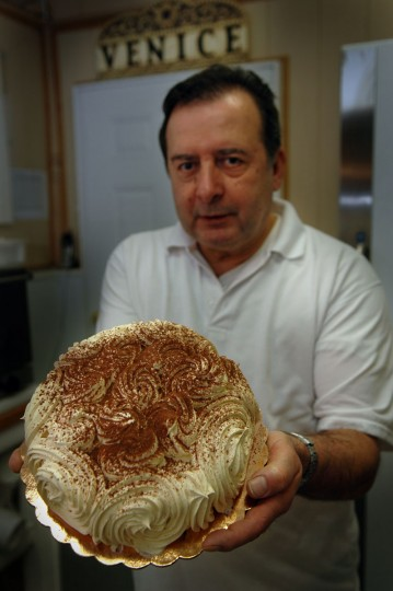 A 2006 photo of Antonio Iannaccone from The Baltimore Sun. The caption: Carminantonio Iannaccone claims to have invented Tiramisu when he lived in Italy. Since a gourmet newsletter wrote about the claim -- and swooned for his pastry -- the phone and e-mail orders have been pouring in. He poses with Tiramisu at his Piedigrotta Italian Bakery in Cross Street Market. (CHIAKI KAWAJIRI/Baltimore Sun)