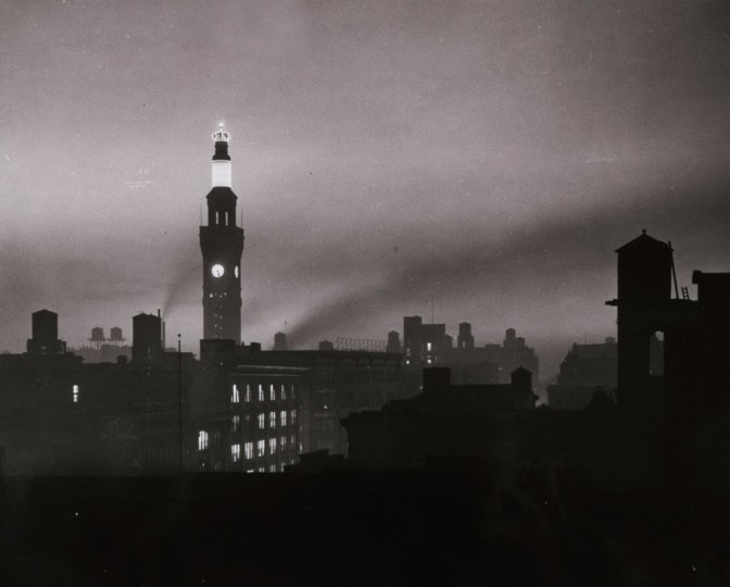 The Bromo Seltzer Tower dominates the Baltimore skyline at dusk in the early 1930s.