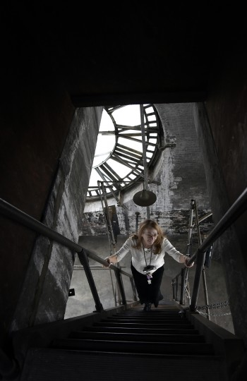 Betsy Stone, leasing administrator at the Bromo Seltzer building, climbs a set of stairs to one of upper levels of the clock tower.  The tower was built by Isaac Edward Emerson and has been a Baltimore landmark since 1911.    (Barbara Haddock Taylor/Baltimore Sun)