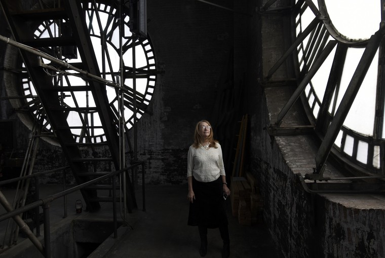 Betsy Stone, leasing administrator at the Bromo Seltzer building, stands in the clock tower.  The building was built by Isaac Edward Emerson and has been a Baltimore landmark since 1911. The clock is currently being refurbished in Maine.    (Barbara Haddock Taylor/Baltimore Sun)