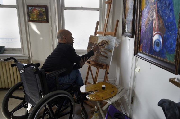 Tommy Roberts paints a portrait in the studio he shares with another artist at the Bromo Seltzer building. There are 14 floors of artists' studios.   (Barbara Haddock Taylor/Baltimore Sun)