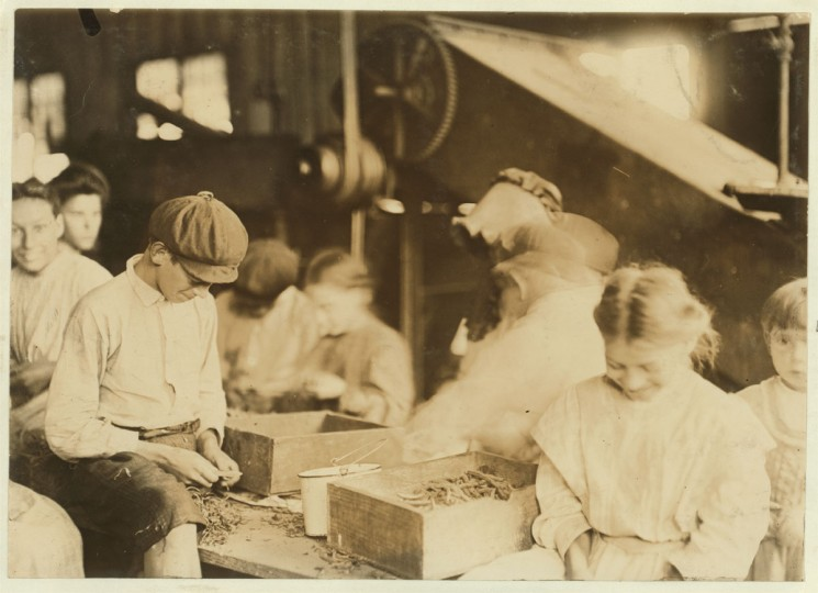 Group of workers stringing beans in J. S. Farrand Packing Company, Baltimore, Md. Many youngsters work here. Photo July 7, 1909. Location: Baltimore, Maryland. (Lewis Hine/Photo courtesy LOC)