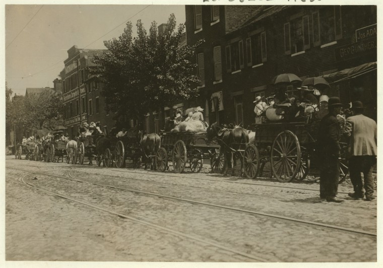 A street full of Baltimore immigrants lined up and ready to start for the country to the berry farms. Wolfe Street, near Canton Avenue, Baltimore, Maryland. Courtesy of Maryland Child Labor Committee. Location: Baltimore, Maryland. 1910 May. (Lewis Hine/Photo courtesy LOC)