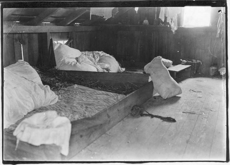 Original Caption: Interior of one family room on upper floor of one of the berry picker shacks, Bottomley's farm. Rock Creek, Md, June 1909. (Lewis Hine/Photo courtesy of NARA)