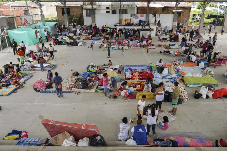 Local residents are housed in a shelter for victims of the mudslides caused by heavy rains in Mocoa, Putumayo department, southern Colombia, on April 5, 2017. A state of economic emergency has been declared in the town of Mocoa in southern Colombia, after mudslides left more than 290 people dead. And local officials urged the government to dispatch more police and troops to secure the region and prevent the looting of abandoned homes. (LUIS ROBAYO/AFP/Getty Images)