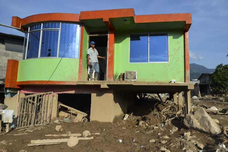 A man stands in the doorway of his house, which was damaged by a mudslide caused by heavy rains in Mocoa, Putumayo department, Colombia on April 5, 2017. A state of economic emergency has been declared in the town of Mocoa in southern Colombia, after mudslides left more than 290 people dead. And local officials urged the government to dispatch more police and troops to secure the region and prevent the looting of abandoned homes. (LUIS ROBAYO/AFP/Getty Images)