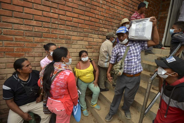 A man carries a box with aid for people displaced by the floods in Mocoa, Putumayo department, southern Colombia on April 5, 2017. A state of economic emergency has been declared in the town of Mocoa in southern Colombia, after mudslides left more than 290 people dead. And local officials urged the government to dispatch more police and troops to secure the region and prevent the looting of abandoned homes. (LUIS ROBAYO/AFP/Getty Images)
