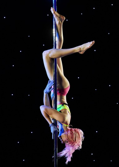 Samantha Anderson competes in the 2017 Pacific Pole Championships at the Convention Center in Los Angeles, California on April 8, 2017. Combining dance and acrobatics, originally began as entertainment in strip clubs, pole dancing soon became mainstream as a form of exercise and expression. Competitions are now held in countries throughout the world and has a participant level estimated at over 30,000 in the US. (Mark Ralston/AFP/Getty Images)