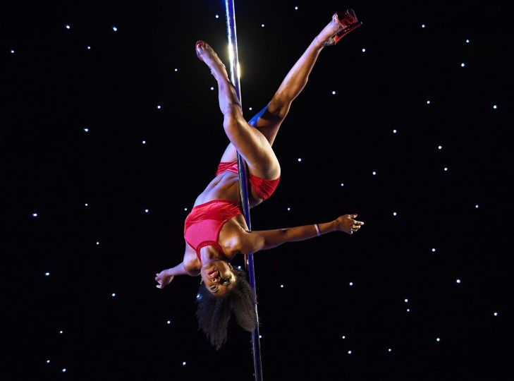 Chenita from the Luscious Maven Studio competes during the 2017 Pacific Pole Championships at the Convention Center in Los Angeles, California on April 8, 2017. Combining dance and acrobatics, originally began as entertainment in strip clubs, pole dancing soon became mainstream as a form of exercise and expression. Competitions are now held in countries throughout the world and has a participant level estimated at over 30,000 in the US. (Mark Ralston/AFP/Getty Images)