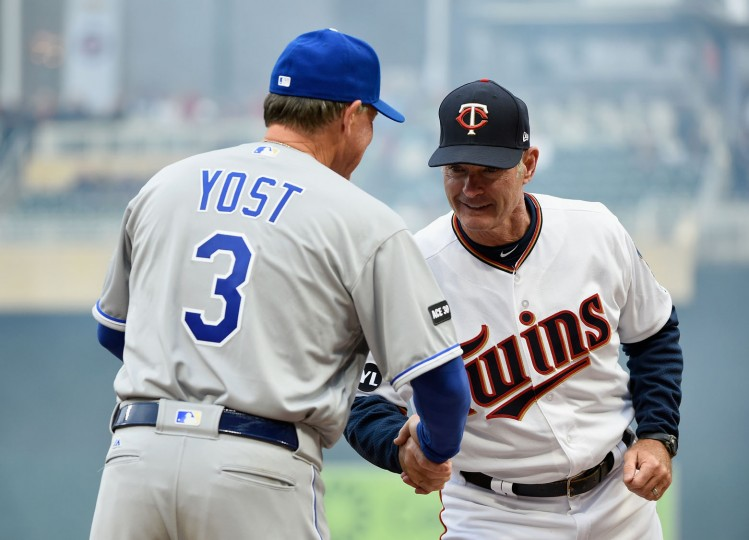 Manger Ned Yost #3 of the Kansas City Royals and manager Paul Molitor #4 of the Minnesota Twins shake hands before the Opening Day game on April 3, 2017 at Target Field in Minneapolis, Minnesota. (Photo by Hannah Foslien/Getty Images)