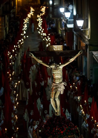 "Penitents members of the ""Real Hermandad del Santisimo Cristo de las Injurias"" carry a Jesus Christ sculpture as they parade during the ""Silence"" procession during Holy Week in the northwestern Spanish city of Zamora on April 12, 2017. Christian believers around the world mark the Holy Week of Easter in celebration of the crucifixion and resurrection of Jesus Christ. (Cesar Manso/AFP/Getty Images)"