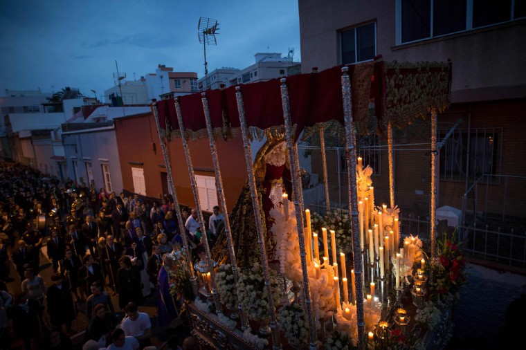 Members of the brotherhoods of Our Captive Father Jesus before Caiaphas and Our Lady of Sorrows participate in the Procession of the Encounter between the image of the Holy Mary of Sorrows and Our Captive Father before Caiaphas during Holy Week in La Laguna on the Spanish Canary Island of Tenerife, on April 11, 2017. (Desiree Martin/AFP/Getty Images)
