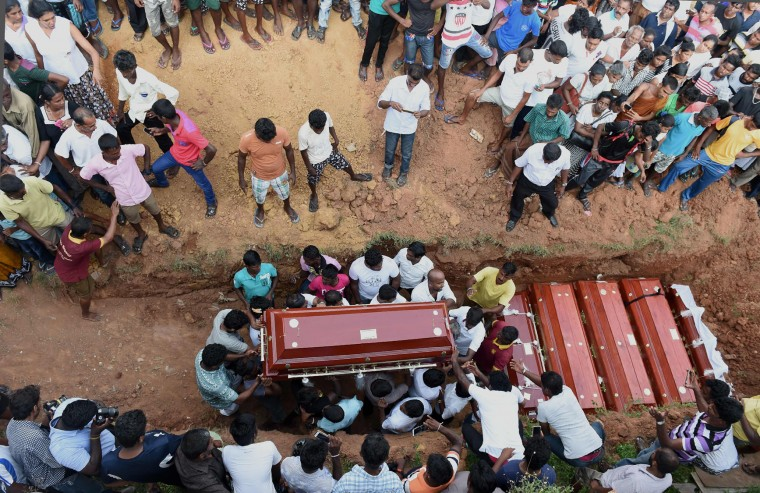 Sri Lankan families carry the coffins of victims who died following the collapse of a garbage dump in Colombo on April 17, 2017. Sri Lanka has moved over 400 families to temporary shelters after tonnes of rotting garbage collapsed onto a slum on April 14, killing at least 28 people. (Ishara S. Kodikara/AFP/Getty Images)