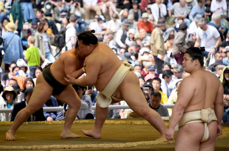 "Sumo wrestlers take part in a ""honozumo,"" a ceremonial sumo exhibition, on the grounds of Yasukuni Shrine in Tokyo on April 17, 2017. Sumo's top wrestlers took part in an annual one-day exhibition for thousands of spectators within the shrine's precincts. (TOSHIFUMI KITAMURA/AFP/Getty Images)"