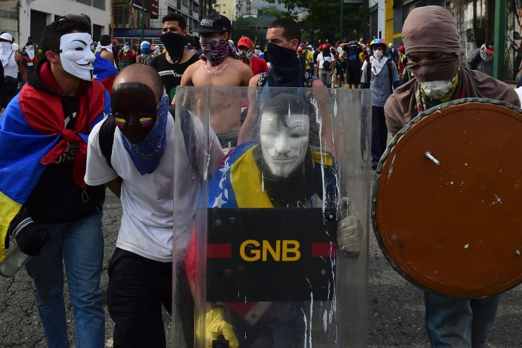 Demonstrators protest during a rally against Venezuelan President Nicolas Maduro, in Caracas on April 19, 2017. Venezuela braced for rival demonstrations Wednesday for and against President Nicolas Maduro, whose push to tighten his grip on power has triggered waves of deadly unrest that have escalated the country's political and economic crisis. (Ronaldo Schemidt/AFP/Getty Images)