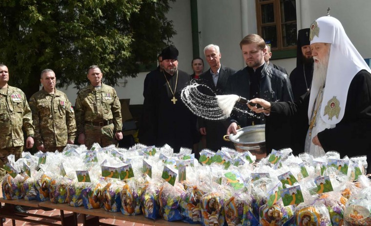 Patriarch of Ukrainian Orthodox Church (Kiev Patriarchy) Filaret blesses Easter eggs and paskhas to be sent to Ukrainian servicemen fighting against pro-Russian separatists in Eastern Ukraine, during a ceremony in Kiev on April 12, 2017. Ukrainian believers will celebrate the Easter, main holiday in Orthodox church, on April 16, 2017. (SERGEI SUPINSKY/AFP/Getty Images)