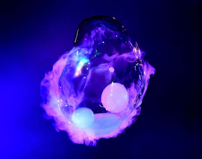 Bubble artist Deni Yang creates a bubble using dry ice during his Mega Bubblefest Laser Show at the Discovery Cube Science Center in Santa Ana, California, on April 6, 2017. Deni, who is the son of famed bubble master Fan Yang, has followed in his father's footsteps and travels the world performing his bubble shows. His family holds the world record for largest soap bubble, measuring 167 feet long, that was created in Beijing, China in 2009. (Mark Ralston/AFP/Getty Images)