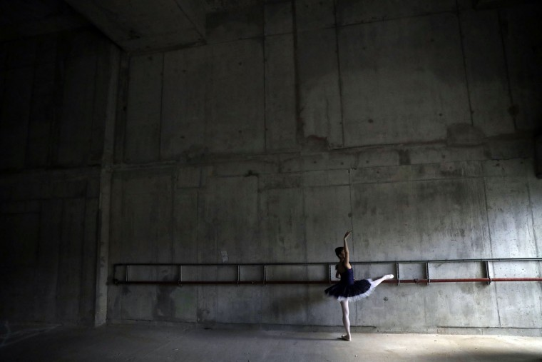 Moeno Oba, from Japan, a dancer from the Central School of Ballet holds a pose for photographers during a photocall in the unfinished interior of their new building on Paris Garden in the Southwark area of London, Tuesday, March 21, 2017. The school are undertaking a 6 million pound fundraising campaign to finish the building developments and are going on a five-month, 23 date tour around Britain from March 30 onwards. (AP Photo/Matt Dunham)