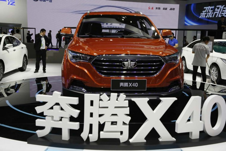 The X40 SUV from Chinese automaker FAW is displayed during the Auto Shanghai 2017 show at the National Exhibition and Convention Center in Shanghai, China, Wednesday, April 19, 2017. Models on display at Auto Shanghai 2017, the global industry's biggest marketing event of the year, reflect the conflict between Beijing's ambitions to promote environmentally friendly propulsion and Chinese consumers' love of hulking, fuel-hungry SUVs. (AP Photo/Ng Han Guan)