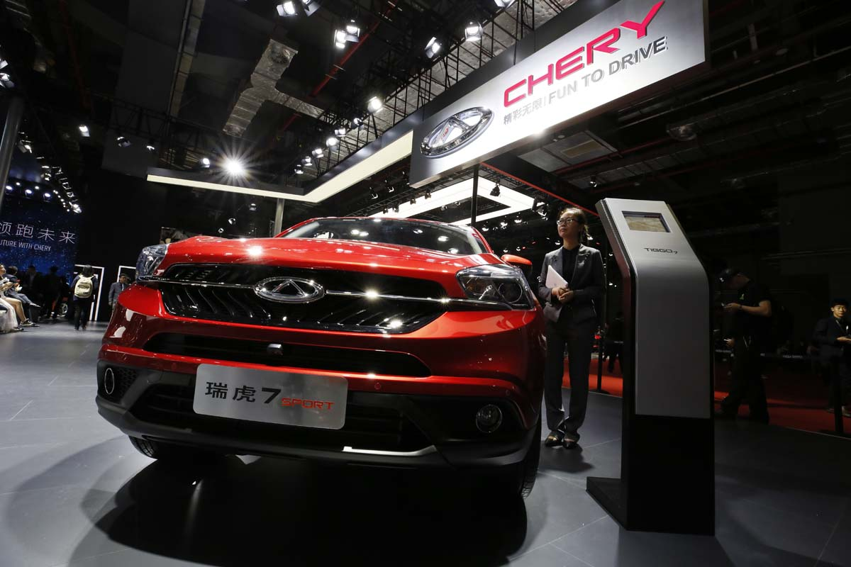 A Worker Stands Near Vehicle At The Chery Stand During Auto Shanghai 2017 Show National Exhibition And Convention Center In China