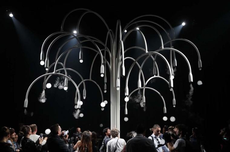 """People visit an installation called """"New Spring"""" by Studio Swine for Cos' furniture designers, part of the Design Fair exhibition in Milan, Italy, Thursday, April 6, 2017. It is a multi-sensory installation. (AP Photo/Antonio Calanni)"""