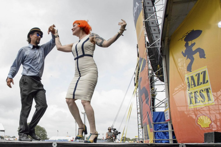 Meschiya Lake and the Little Big Horns perform on the Acura stage with Lake dancing with Chance Bushman at the New Orleans Jazz and Heritage Festival 2017 at the Fair Grounds in New Orleans, La., on Friday, April 28, 2017. (Matthew Hinton/The Advocate via AP)