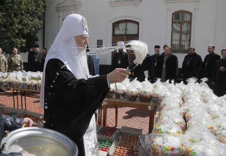 The head of the Ukrainian Orthodox Church Patriarch Filaret blesses traditional Easter cakes and painted eggs prepared for soldiers on front line on Eastern Ukraine for Easter celebrations in Kiev, Ukraine, Wednesday, April 12, 2017. (AP Photo/Efrem Lukatsky)