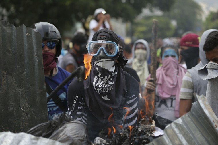 "Anti-Government protesters stand at a barricade in Caracas, Venezuela, Wednesday, April 19, 2017. Tens of thousands of opponents of President Nicolas Maduro flooded the streets of Caracas in what's been dubbed the ""mother of all marches"" against the embattled president. (AP Photo/Fernando Llano)"