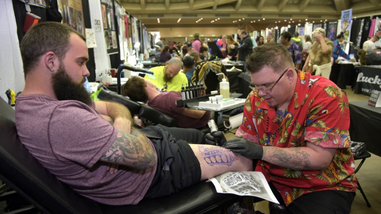 "Troy Foote (cq), 21, from Easton, gets a tattoo of a 5.3 LS chevy motor on his leg by artist Robin ""Punky"" Lasky at the Baltimore Tattoo Arts Convention held this weekend at the Baltimore Convention Center for the 10th year in a row. It's sponsored by Villain Arts. (Algerina Perna/Baltimore Sun)"