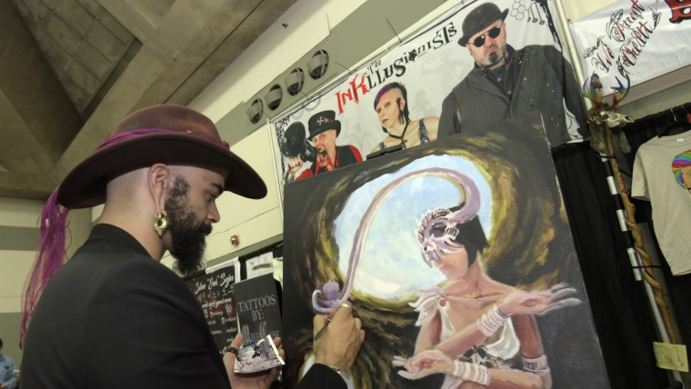 Harrison L. Crawford, a painter from Station North in Baltimore and the vice president of Art Monkeys, creates art at the Baltimore Tattoo Arts Convention. (Algerina Perna/Baltimore Sun)