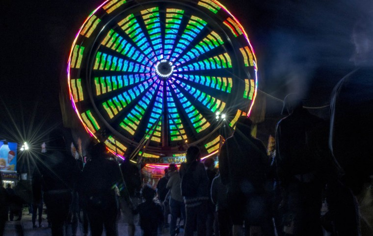 Visitors line up to ride The Big Wheel, a LED ferris wheel at Light City Baltimore on Wednesday, April 5, 2017. (Emma Harris/Baltimore Sun)