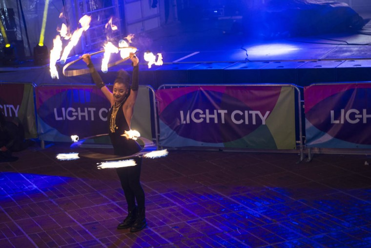A performer with PYROXOTIC, an all-female performance troupe, twirls hoops of fire during Light City Baltimore on Wednesday, April 5, 2017. (Emma Harris, Baltimore Sun)