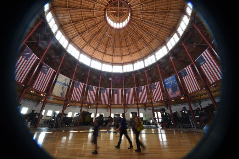 Visitors walk through the Baldwin Roundhouse at the B&O Railroad Museum. (Barbara Haddock Taylor/Baltimore Sun)