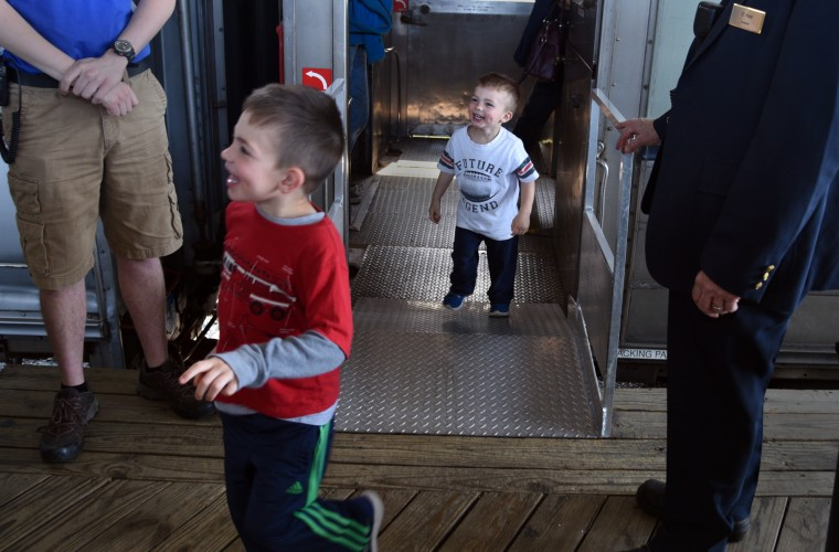 Charlie Nash, 3, left, and his brother Jack, 2, leave the train after a ride at the B&O Railroad Museum. They are from Catonsville. (Barbara Haddock Taylor/Baltimore Sun)