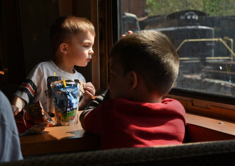 Two-year-old Jack Nash of Catonsville looks out a window during a train ride at the B&O Railroad Museum. (Barbara Haddock Taylor/Baltimore Sun)