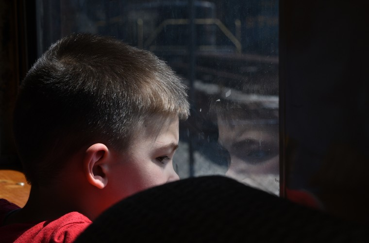 Three year old Charlie Nash of Catonsville looks out a window during a train ride at the B&O Railroad Museum. (Barbara Haddock Taylor/Baltimore Sun)