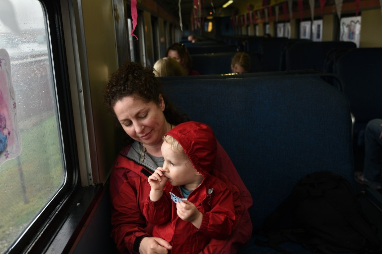 Erica Kaiser, of Baltimore, holds her 2-year-old son Flynn on their train ride at the B&O Railroad Museum. (Barbara Haddock Taylor/Baltimore Sun)