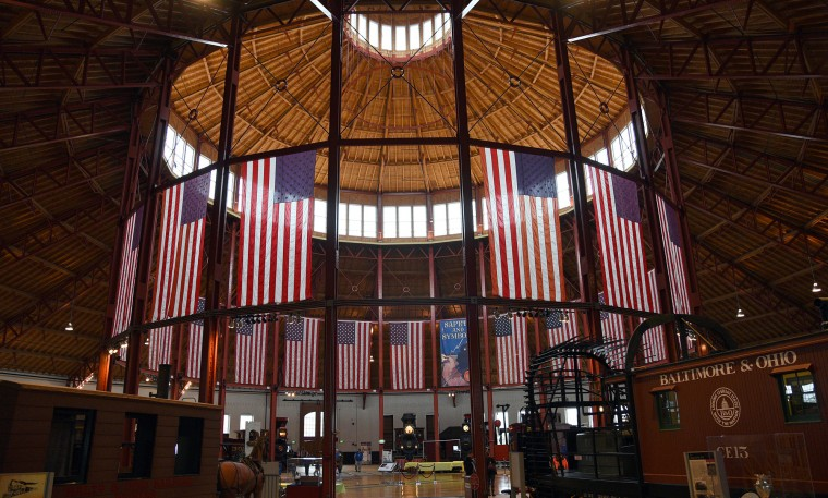 The Roundhouse at the B&O Railroad Museum is decorated with American flags.  (Barbara Haddock Taylor/Baltimore Sun)
