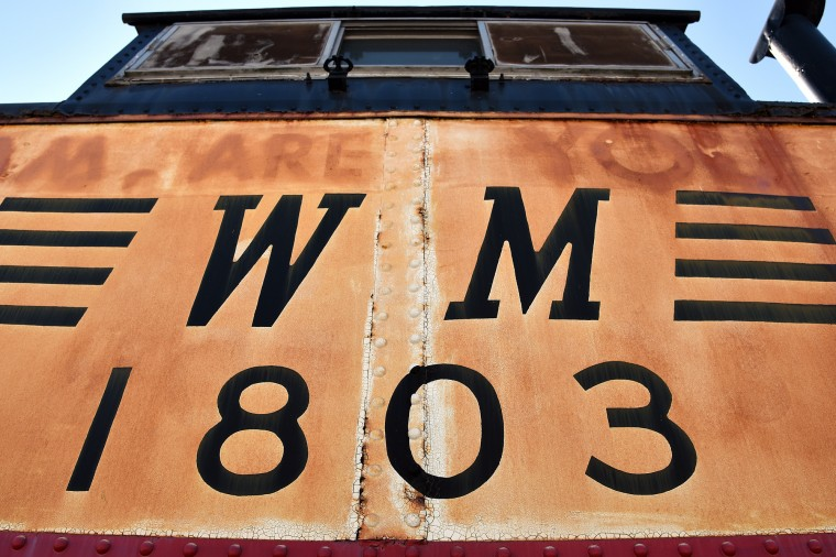 The Western Maryland 1803, a steel caboose dating from 1936, is on display outside at the B&O Railroad Museum.  (Barbara Haddock Taylor/Baltimore Sun)