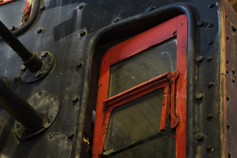 The crew door on the C & O 4-6-0 ten wheeler steam locomotive is painted red.  It is one of the oldest existing steam locomotives and is on display in the North Car Shop at the B&O Railroad Museum.  (Barbara Haddock Taylor/Baltimore Sun)