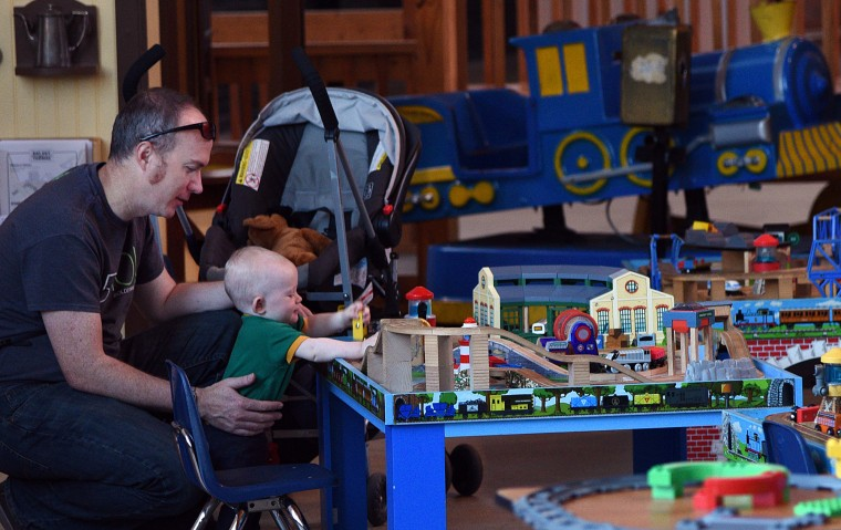 Aaron Zimenoff, left, and his 10 month old son Raylan, who are from Fort Collins Colorado, play in the Thomas-themed children's play area in the roundhouse at the B&O Railroad Museum.  (Barbara Haddock Taylor/Baltimore Sun)