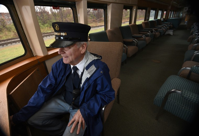 Duncan Keir keeps his hand on the emergency brake in case he sees someone on the tracks ahead. (Barbara Haddock Taylor/Baltimore Sun)