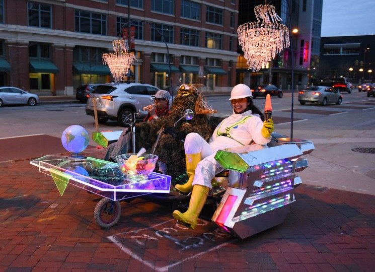 The Kinetic Kauchii/DekoSofa travels along Pratt Street during the media preview of Light City 2017 Thursday night. (Jerry Jackson, Baltimore Sun)