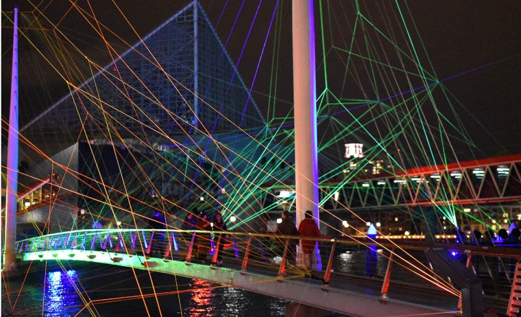 OUR HOUSE by Tom Dekyvere consists of illuminated nylon stretched across the suspension bridge between Piers 3 and 4. (Jerry Jackson, Baltimore Sun)