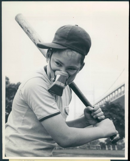 A youngster wears a face mask to play baseball in the smog in photo dated July 31, 1970. (Baltimore Sun archives)