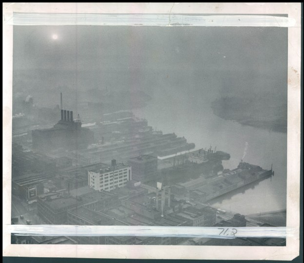 Sun shines through smog and haze over harbor and city, November 20, 1953. (Klender/Baltimore Sun)