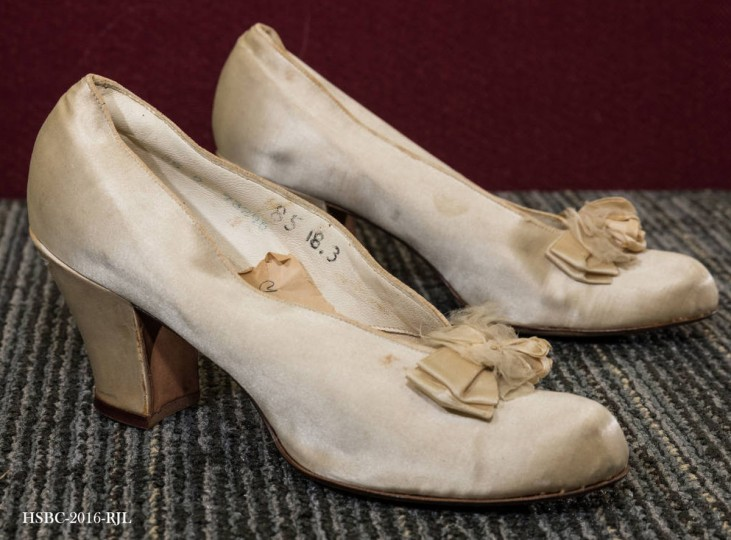 "White satin wedding slippers with bow. Note inside reads ""my wedding slippers."" Worn by Mrs. Benjamin Harris's mother. Gift of Dr. and Mrs. Benjamin Harris. (Photo from the Baltimore Historical Society via Enoch Pratt Library)"